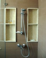 Hanging glass shower doors are clamped with a rubber gasket
