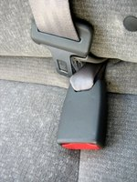 Slide the seat belt buckle out of the way for easy removal of the back seat.
