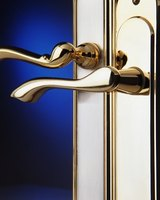 Clean brass door handles with acidic lemon juice or vinegar.