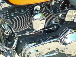 The ignition coil on a Harley Davidson motorcycle is an essential component of the ignition system.