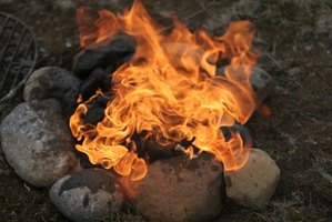 Build a fire pit for cooking while camping.