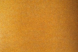 Abrade the paneling to promote adhesion by sanding it with a fine-grit sandpaper.