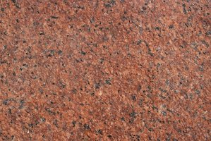 Clean your granite with dish soap and rubbing alcohol.