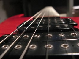 Tuning your guitar with a tuner helps ensure the strings are the correct pitch