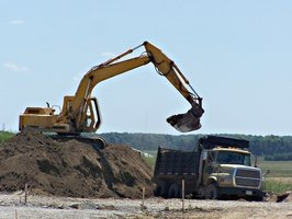 Make sure the dump truck brings you enough fill dirt using a simple calculation.