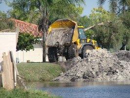 a dump truck driver hauls loose materials to and from job sites dump truck driver job description