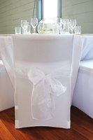 Handmade chair covers can add sophistication to a wedding reception without a lot of expense.