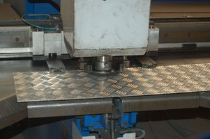 Cutting aluminum sheeting only requires a carbide blade and a good power saw.