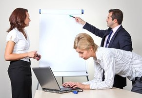 Management training includes how to give effective presentations.