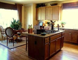 Kitchen cabinets are constructed from various types of wood.