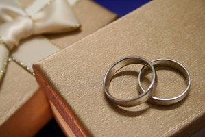 Wedding Gift Etiquette Remarriage : pair of wedding rings on top of exquisite gift boxes. image by weim ...