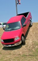 A pickup truck is a motor vehicle with an open-top cargo area in the rear.