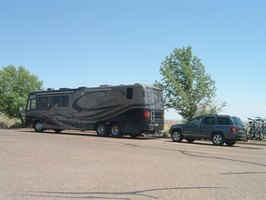 "RV tow dollies hold a specific set of advantages over towing your car ""four-down."""