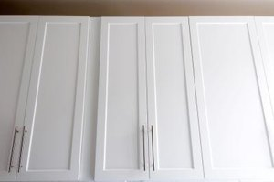 Overhead kitchen cabinets may extend all the way to the ceiling.