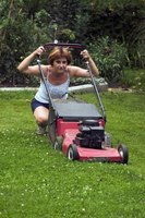 Clumps of heavy, wet grass sometimes can keep a lawn mower from working.