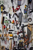 Organize your garage with pegboard and hooks.