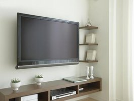 Surround your flat screen with floating shelves so it blends into the design.