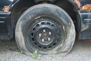 A tire loses air quickly when its bead does not seat properly on the wheel rim.