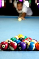 A Valley pool table has a flat playing surface covered with felt to allow the balls to roll smoothly and evenly.