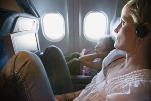 Watching in-flight movies can prove a distraction from cigarettes