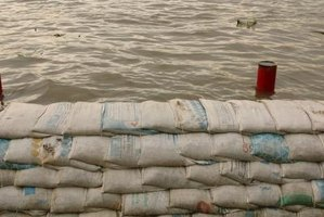 Construct a sandbag barrier to protect your property from flood waters.