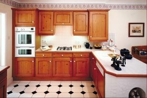 Replace Doors on a Kitchen Cabinet With Curtains