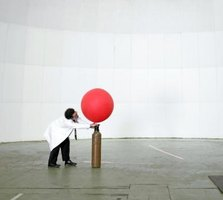 Adding air to a ballon increases the pressure, evenutally causing it to pop.