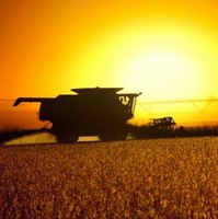 The John Deere 7720 combine is used to harvest grains.