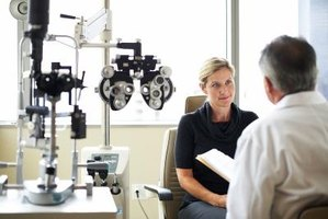 An ophthalmologist performs examinations to locate symptoms for eye disorders.