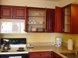 The average depth of upper counter cupboards ehow for Average depth of kitchen cabinets