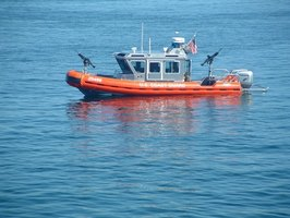 The U.S. Coast Guard enforces its boat regulations out on the water.