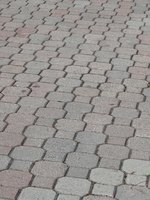 A concrete toe helps hold together a project made of pavers.