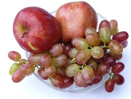 Fruit like apples and grapes are healthy alternatives to candy and soda.