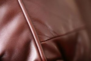 Repair a bleach stain on your leather couch with specially made leather dye.