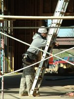 Construction workers build houses and commercial buildings.