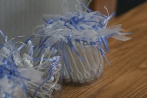 Tinge white tulle with blue ribbon on the decorations.