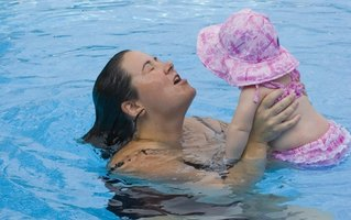 Your child is ready for mommy and me time at the pool by 6 months old.