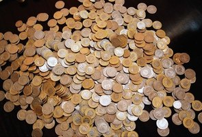 Incorporate real coins into a math lesson plan for students with autism.