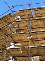 Scaffolds like these sometimes require additional planks to span the frames.