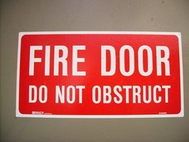Fire doors double as smoke doors, however not all smoke doors protect against flames.