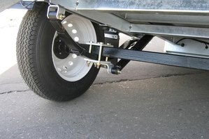 A tow dolly lifts both front wheels of the car off of the ground.