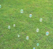 Blowing bubbles in the yard is one fun activity for children.