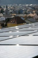 Solar panels catch the sun's rays to heat a home.
