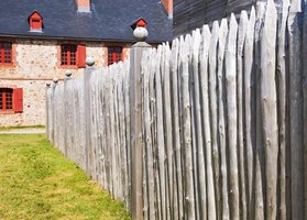 Wood fencing left untreated will eventually turn gray and development cracks and splits from expose to sun and rain.