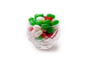 Make a colorful candy garland for your tree by stringing jelly beans on dental floss.
