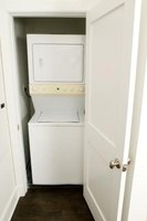 A combo washer-dryer is one solution for tight spaces in a condo.