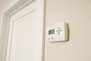 Digital wall thermostat with LCD display.