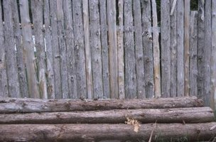 Cedar logs usually have the bark removed for building purposes.