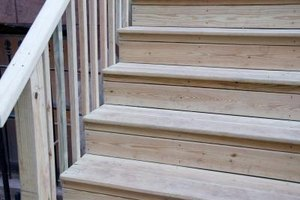 Treat your outdoor wooden steps with a semi-transparent stain to protect the wood.