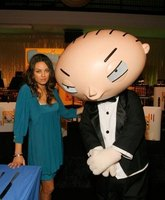 "Actress Mila Kunis with ""Family Guy"" character Stewie."